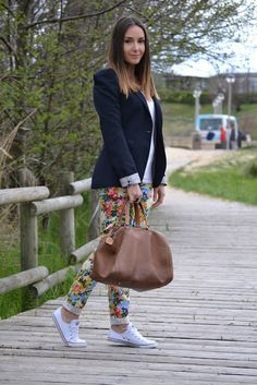 Love those flower printed jeans with navy blazer and converses :)