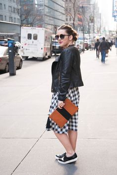 {Checkered Spring Dress | Simply Audree Kate} Black and white gingham print dress styled with a flat stripe clutch, messy bun, and round sunglasses