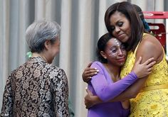 Heabunie Hubles, 15, gets emotional as she hugs Michelle Obama after performing...