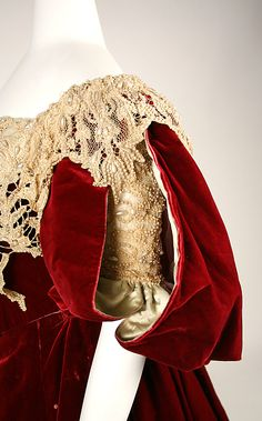 Red silk velvet evening dress (sleeve detail, with off-the-shoulder bodice with Battenburg lace bertha), by Charles Frederick Worth, French, 1893-95.