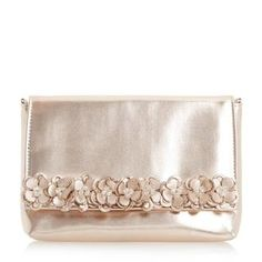 Add a glamorous finishing touch with this flower embellished clutch bag. A classic flap over style with a magnetic snap button closure. An optional shoulder chain strap and inner pocket complete the design.