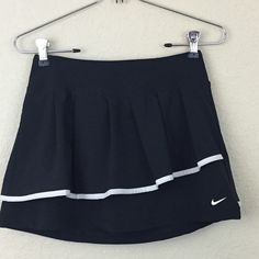 Nike tennis Dri fit skirt Nike tennis Dri fit skirt black size XS worn 2 times no damages shorts attached underneath $60 Nike Skirts
