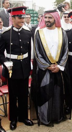 (R-L) The Emir, Sheikh Mohammad bin Rashid Al Maktoum of Dubai stands with his son, Sheikh Majid Bin Mohammad Al Maktoum of Dubai after his Passing Out Parade at Sandhurst Military Academy on 11 Aug 2006