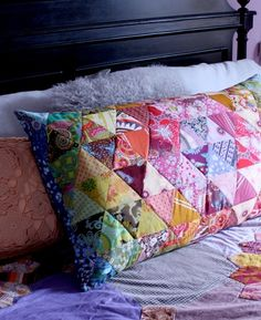Patchwork - love the colors on the pillow.  Looks like a miniature version of a hexagon quilt of hers.