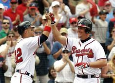 4/15/12: Atlanta Braves' Chipper Jones, right, celebrates with Martin Prado after hitting a three-run home run in the third inning of a baseball game against the Milwaukee Brewers in Atlanta.  Braves win it 7-4.