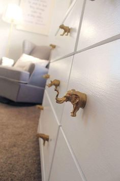 Our nursery. DIY drawer pulls made from plastic animals and gold spray paint