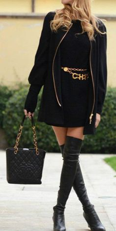 black dress, boots and gold chain belt