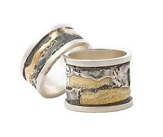 """""""Spool Rings""""  Gold & Silver Ring    Created by Sonia Beauchesne    Oxidized sterling silver and 18k gold ring. The designs are all different and unique"""