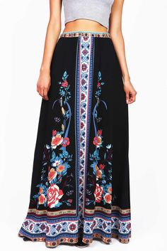 Bold statement maxi skirt with a bright floral prints. Elastic waist band…