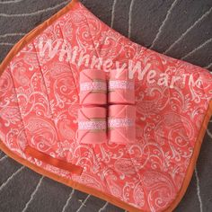 Coral/White Paisley Print English pad with matching polo wraps. www.whinneywear.com