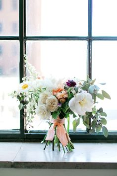 bouquet with peach ribbon - photo by Aubrey Marie Photography http://ruffledblog.com/romantic-ballroom-wedding-in-tulsa