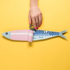 Paper Sardine, layered paper sculpture created for the 2016 Festas de Lisboa annual contest. A paper illustration of a fun sardine being opened like a can.