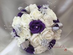 This beautiful latest package, consists of beautiful realistic looking ivory and cadbury purple roses. They are adorned with groups of shimmering silver babies