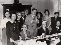 'Monarch of the Glen' writer Compton Mackenzie, an old WaveLength trustee, meets with staff at one of the first BBC radio appeals. At the offices people are busy writing thanks for donations.