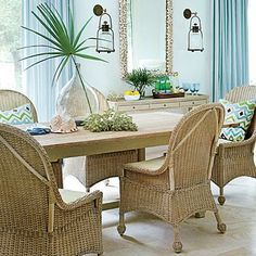 Wicker chairs give this dining space a more laid-back, casual feel.
