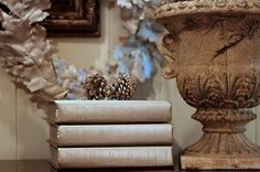 spray painted books - could make pumpkins out of these by stacking different sizes of books