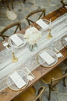 Lace table runners are sweet and feminine without having to add too many additional frills to the table. White lace is a wedding go-to and it's easy to see why. | See more trending table runners for your #wedding here: http://www.mywedding.com/articles/9-trending-table-runners-for-weddings/