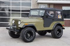 """1973 Jeep CJ5.    This 1973 Jeep CJ5 has a 4.0 Liter Inline 6 Cylinder w/ Weber Carb, 4 Speed Manual Transmission, Dana 30 Rear w/ 4.10:1 Ratio, Dana 44 Front Axle, Power Steering, Disc Brakes, Clifford Intake, Stainless Headers, New Vinyl Top & Doors From Bestop, Procomp Bumpers,12,000 LB Electric Winch, Power Coated Roll Bar & Windshield Frame, SW Gauges, 15"""" Powder Coated Steel Wheels, Hercules Trail Digger Tires, New Drab Green Paint, Undercoated Floors, Beautifully Restored CJ5 w…"""
