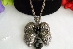 15% off 40617 Marcasite Vintage Long Darkened Silvertone Necklace with Small Black Beads at Bottom of the Pendant Free Shipping to the United States.