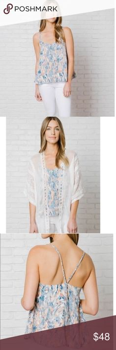 🆕Beautiful abstract print blouse 💕 An ideal off-duty choice, this casual blouse is printed with a painterly design in shades of blue and pink. Constructed in a silk-like fabric with a loose-fitting silhouette, this top is given a feminine feel with its braided straps and dainty, gold-toned hardware at the back. On your next shopping trip, wear this lovely top with a pair of white jeans and nude-hued sandals.  *100% Polyester *Lining: 100% Polyester *Hand wash *Silk-like fabric *Fully lined…