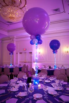 Maybe if you don't want flowers on every table you can find a different setting for the bottom to save on flower cost.  Purple Balloon Centerpiece with Aqua Gems