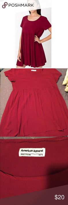 American apparel dark red babydoll t shirt dress This is a super cute SUPER comfortable babydoll dress. Great in winter with a cardigan and tights and great in summer with a pair of cute sandals. I love this piece but it is a little too short for me (I'm 5'9 just for reference). Also this picture makes it look bright red but that's just the lighting it's a much darker burgundy color. American Apparel Dresses Mini