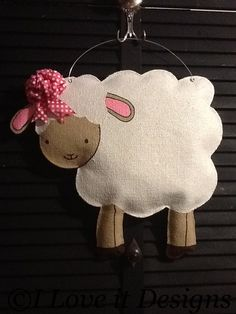 Lamb Burlap Door Hanger on Etsy, $35.00 -- with a yellow bow and hang above cork board, maybe?