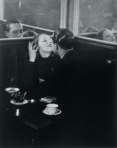 A couple in a café as photographed by Brassai in 1932