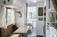 34' 1988 Avion Travel Trailer Renovation Full View / White Paint with Dark Hardwoods / Vintage Decor / Eclectic Decor / White Cabinets / White Tile / Jackalope / Brown Leather Upholstery / Industrial Decor / Industrial Table / Tiny Living / Airstream Renovation / Vintage Travel Trailer Renovation / Travel Trailer Remodel / Minimalism