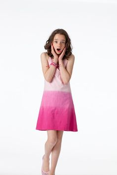 Royalty free photo! Shocked, surprised tween girl in pink dip dye dress. There's no cost for using the shots, but we do ask that you credit the photos to us with a link to www.fashionplaytes.com.