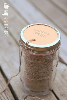 A DIY for making a mason jar twine dispenser plus a bunch of uses for garden twine!