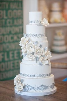Such an amazing wedding cake - love the intricate details #wedding #weddingcake #cake #silver #flowers