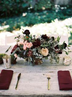 Deep plum ranunculus, burgundy dahlias, and lush greenery // Nashville Wedding Floral Design