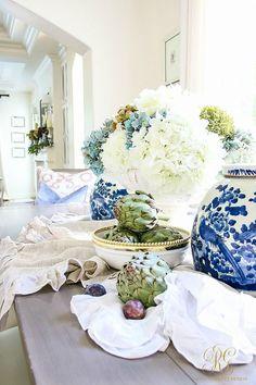 Autumn table vignette with artichokes, blue and white hydrangeas, and ruffled table linens. // Randi Garrett Design