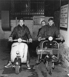 A group of Mods posing with their scooters outside The Scene Club, 1964