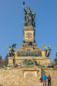 The Niederwalddenkmal is a monument located in the Niederwald landscape park, near Rüdesheim am Rhein in Hesse, Germany. It overlooks the valley of the Rhine and was built in the 1870/80s to commemorate the Unification of Germany.