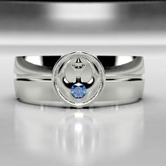 Star Wars tribute Rebel Alliance Ring! This ring comes with a Chatham lab created sapphire for a nice accent stone. Also available with lab created ruby, or emerald. This 6mm wide wedding band is made from recycled gold, palladium, or platinum and is handmade with a comfort fit to your size. The ring is carved from wax, then cast in the metal of your choice. From there it is finished by hand to achieve a great wearable look.   I offer BRUSHED or POLISHED finishes on these rings. Shown in the…