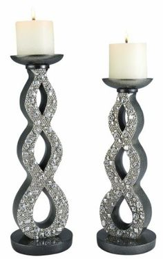 """SET OF 2: 14""""/16""""H SILVER TWILIGHT TWINKLE CANDLE HOLDER SET by OK LIGHTING. $89.99. Approximate Measurements: 14""""/16""""H. 2 candles included. Material: Poly Resin. SET OF 2: 14""""/16""""H SILVER TWINKLE TWILIGHT CANDLE HOLDER SET. Both of these candle holder sets features a metallic glitter silver base with faux crystal-like stones on the front. Enjoy the atmosphere provided by these luxurious candle holders from our classic silver twilight collection."""