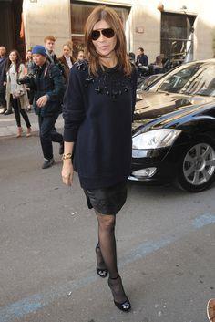 Carine Roitfeld sweater over short skirt