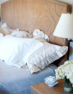 Nailhead patterned headboard. This looks like a serious DIY project. Definitely a statement piece.