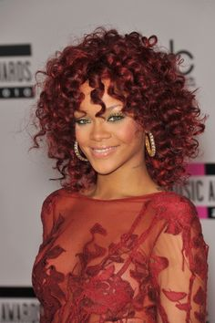 Rihanna gave red hair a try with a medium-length curly style at the 2010 American Music Awards. Photo: Featureflash / Shutterstock.com