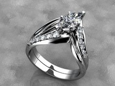 Diamond marquise wedding set by WroughtGold on Etsy. Picture doesn't even do the ring justice. Click to see more pictures!