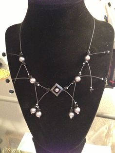 Illusion necklace with black and sliver beads. $15.00, via Etsy.