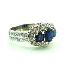 Beautiful Art Nouveau inspired ring hand set with 1.7 carat of 3 exquisite royal blue sapphires and 52 white diamonds in 14K white gold. This ring is made