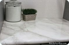 faux-marble-countertop-with-epoxy-coating-via-remodelaholic