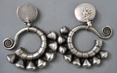 Miao earrings with nice silver old style ear hoops  with added tops for clips. (private collection of Linda Pastorino)