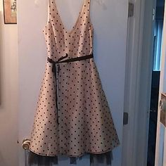 💕host pick💕Retro style polka dot dress This retro style dress is a cream tannish cream color with black polka dots. Three layers. Black ribbon ,ties around the waist. V shaped front and back lines.zip up in the back.small spot on the middle layer. Dry clean only. 🎉 host pick April 2016 🎉 Dresses
