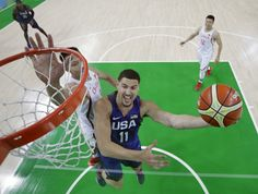United States' Klay Thompson, right, scores past China's Yi Jianlian, left, during a men's basketball