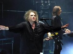 Robert Smith wants to hug his Roger but he's all the way over there