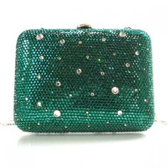 This is an authentic JUDITH LEIBER Swarovski Crystal Minaudiere Monet Green.   This clutch is entirely encrusted in Swarovski crystals in tones of waterlily green.